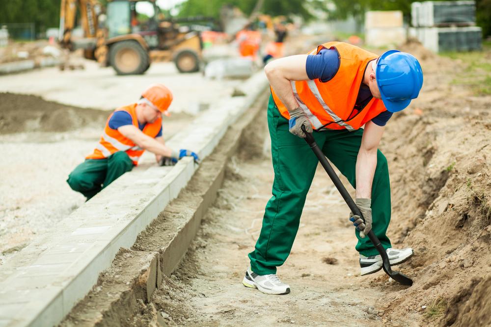 Horizontal image of two builders working hard-1