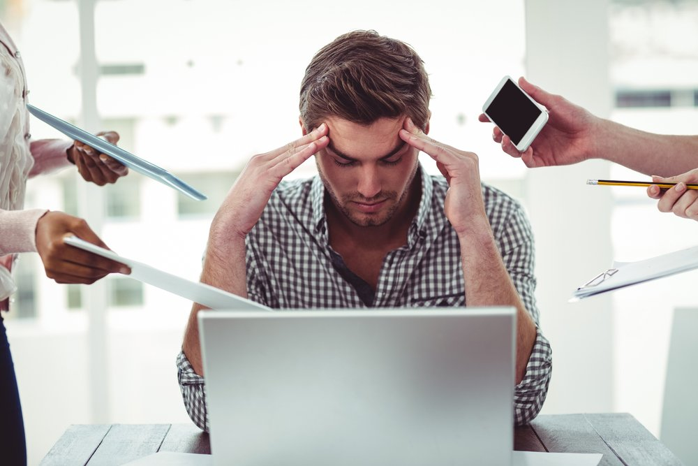 Businessman stressed out at work in casual office