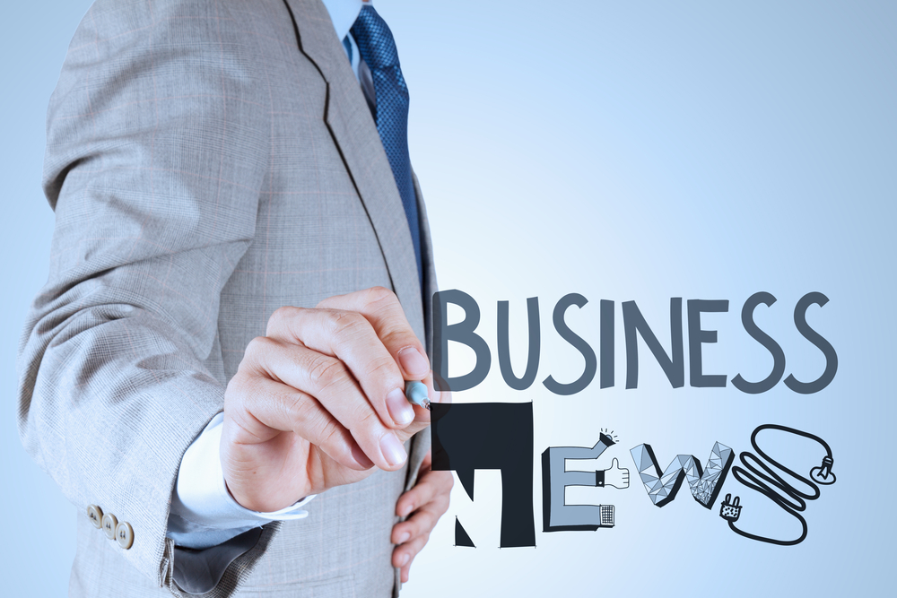 businessman hand draw design word BUSINESS NEWS as concept